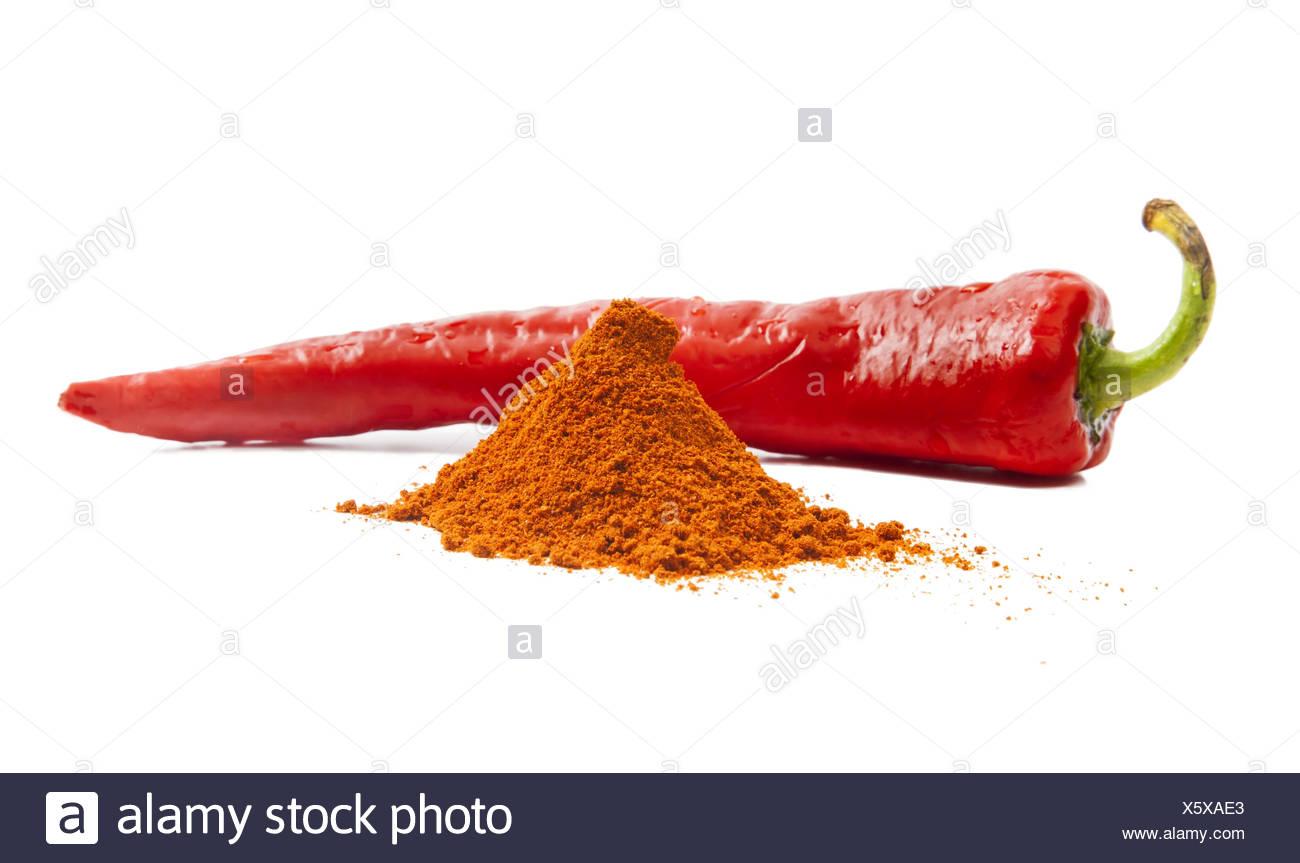 Rote Chilischote und Haufen von rotem Pfeffer Gewürz Stockbild