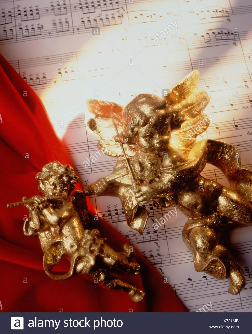 Immer noch leben. Musik Konzept mit Noten und golden Cherub zahlen. Stockbild