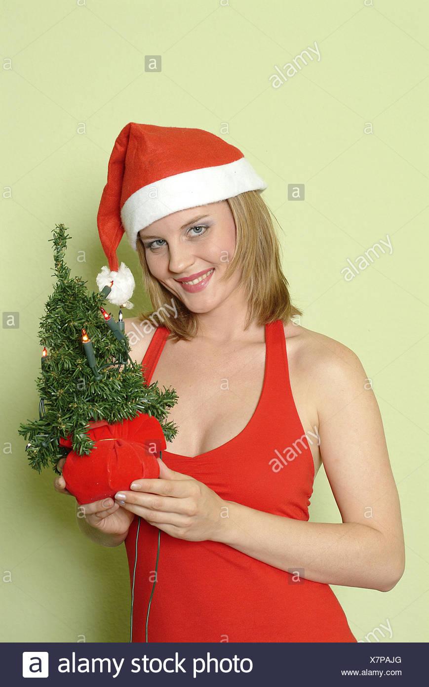 Frau, jung, die Weihnachtsmütze, Weihnachtsdekoration, kleine Bäume ...
