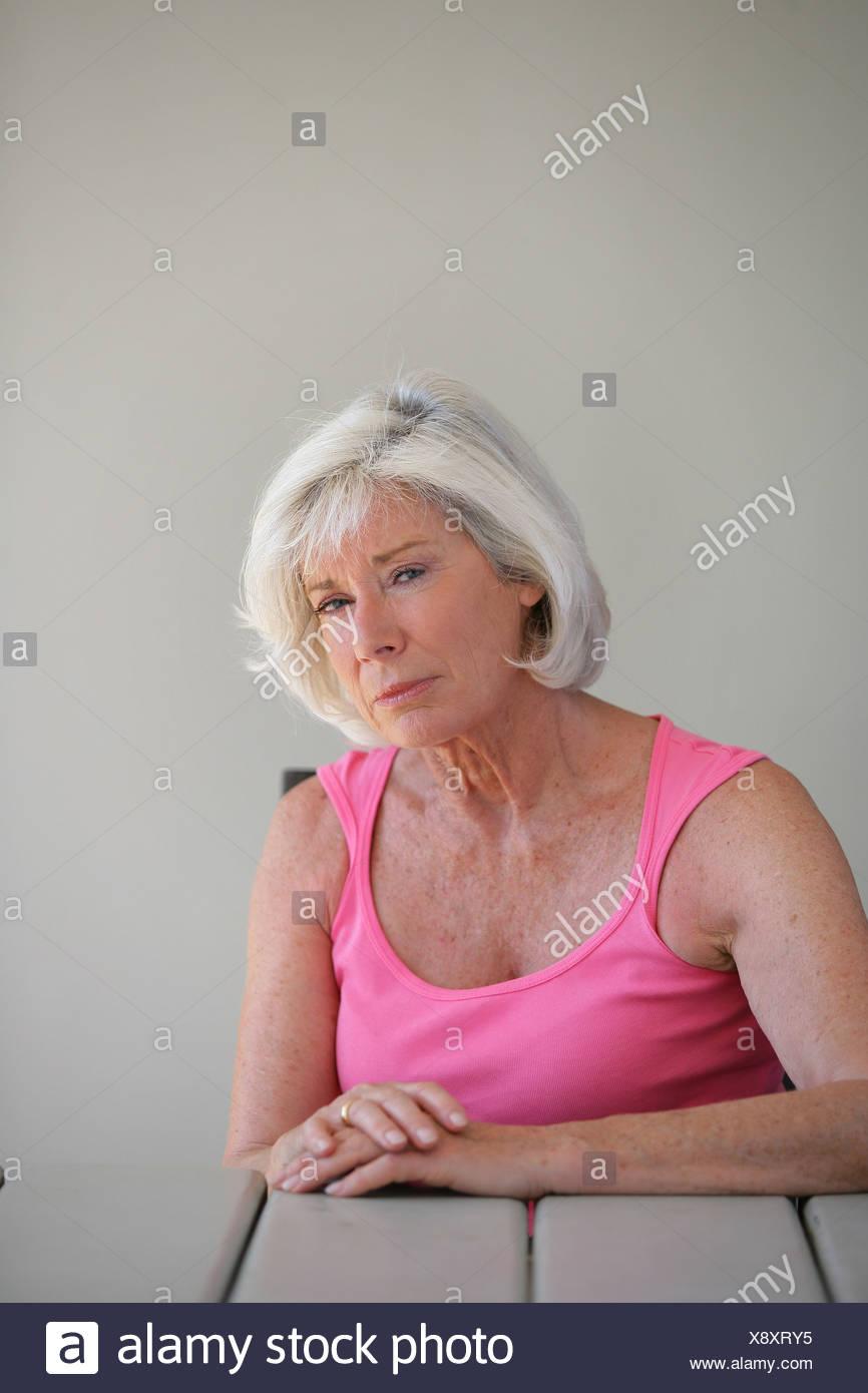 Einsame alte Dame Stockbild