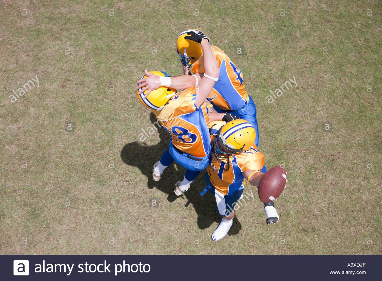 Gewinner-Football-Spieler jubeln Stockbild