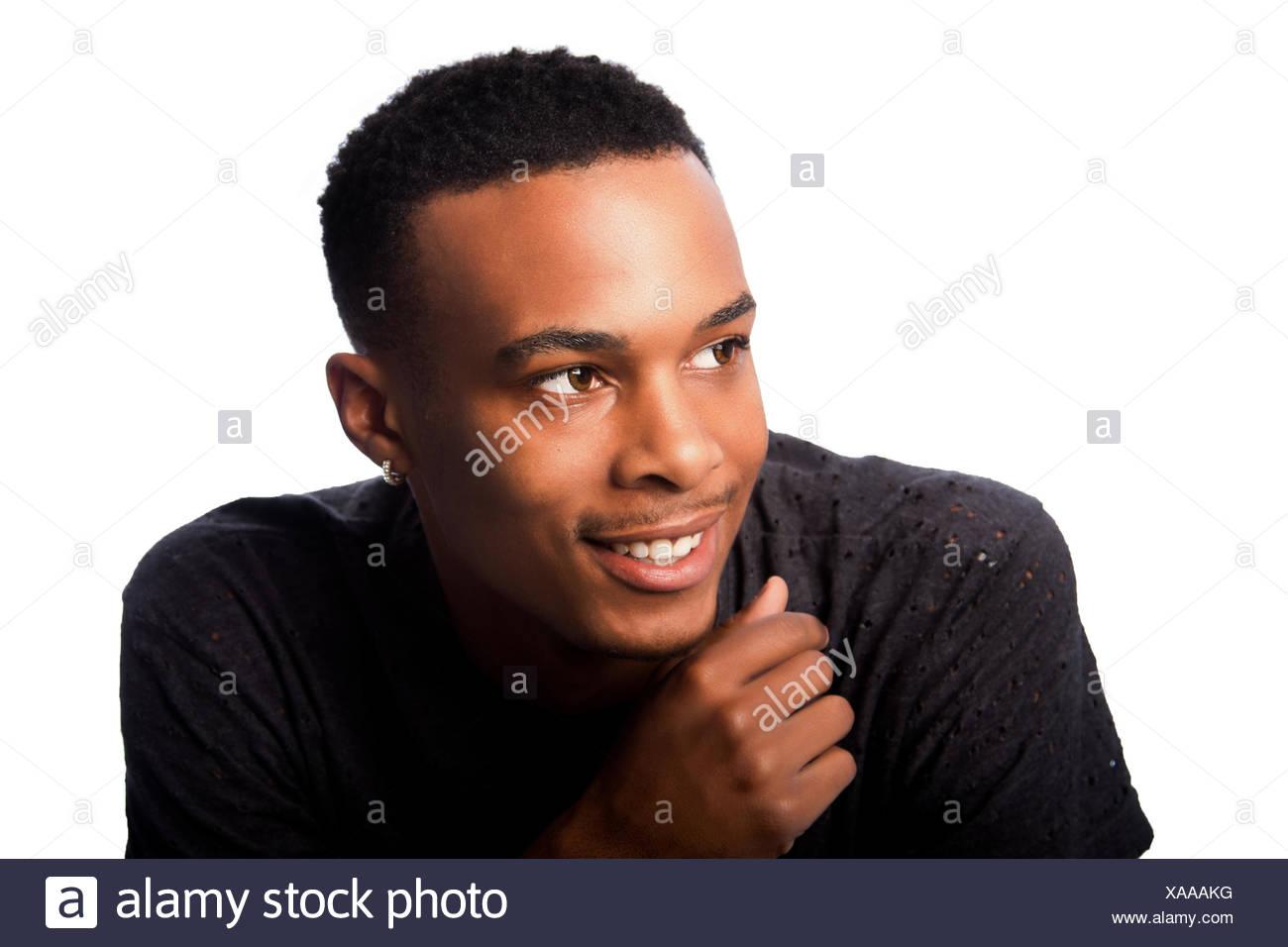 Hübscher glücklich lächelnden Heranwachsenden Mann Stockbild