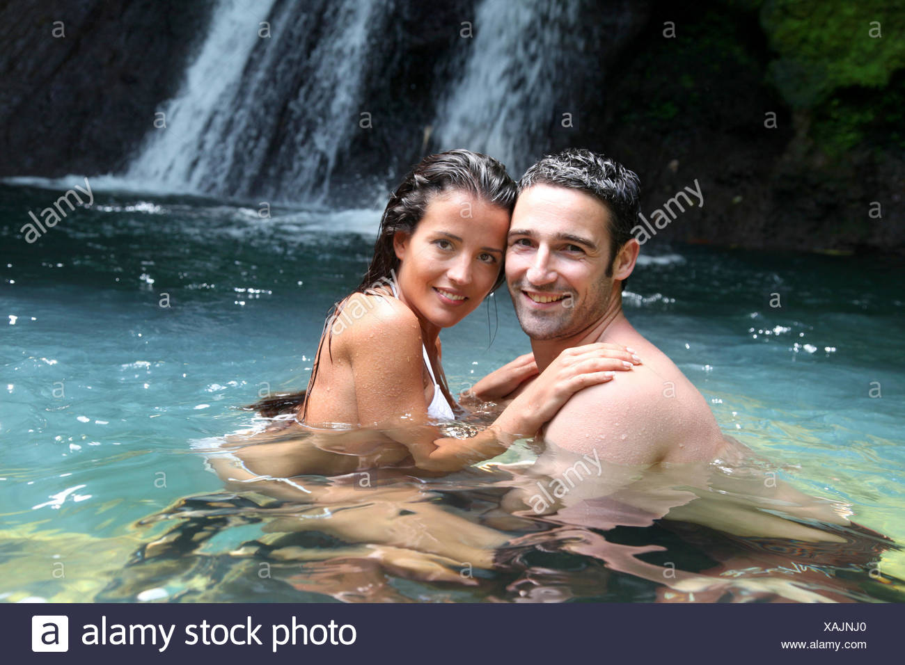 bathing girl waterfall stockfotos bathing girl waterfall bilder alamy. Black Bedroom Furniture Sets. Home Design Ideas