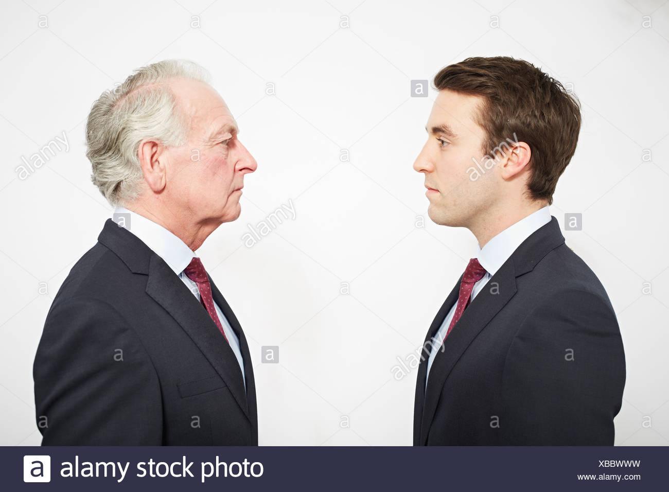Geschäftsleute, die einander zugewandt Stockbild