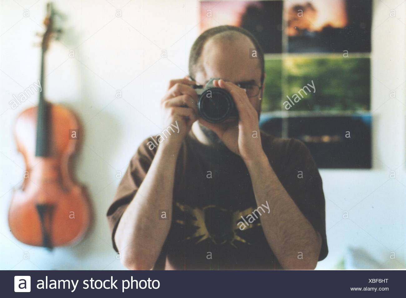 Nahaufnahme eines männlichen Fotografen Stockbild