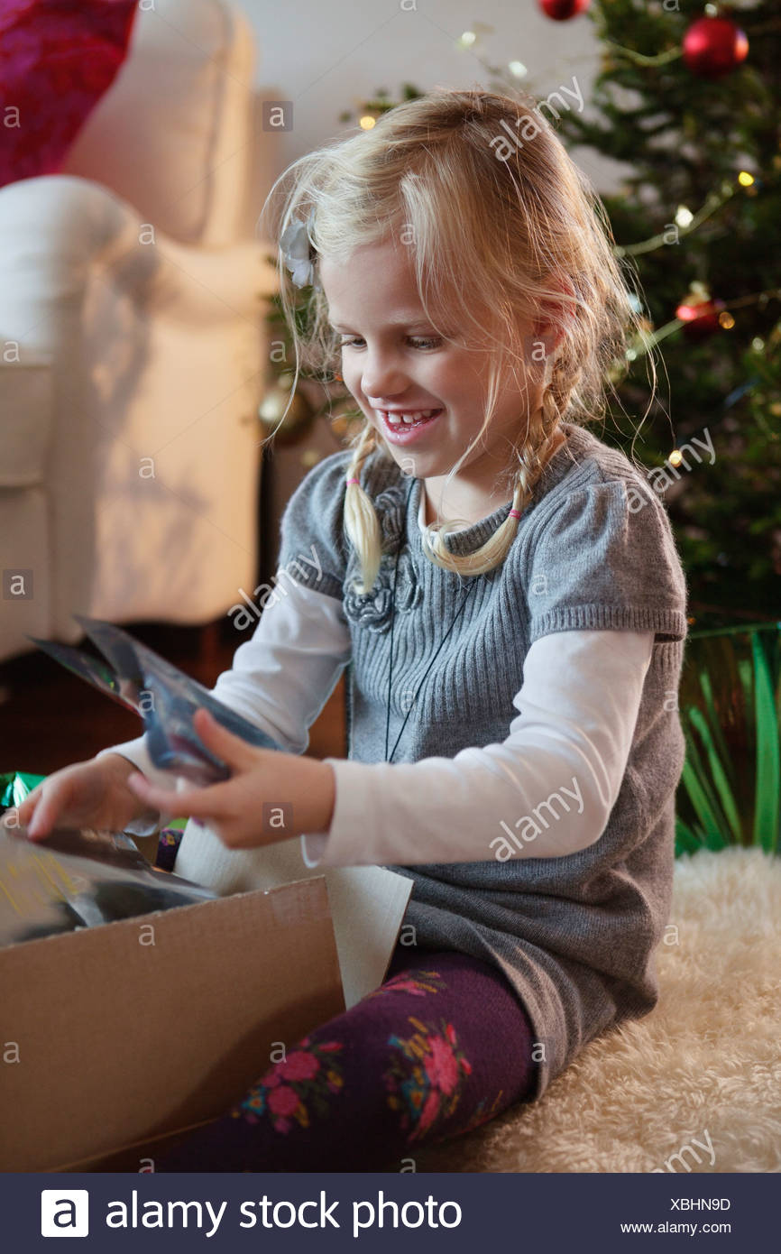 Girl Opening Christmas Present Stockfotos & Girl Opening Christmas ...
