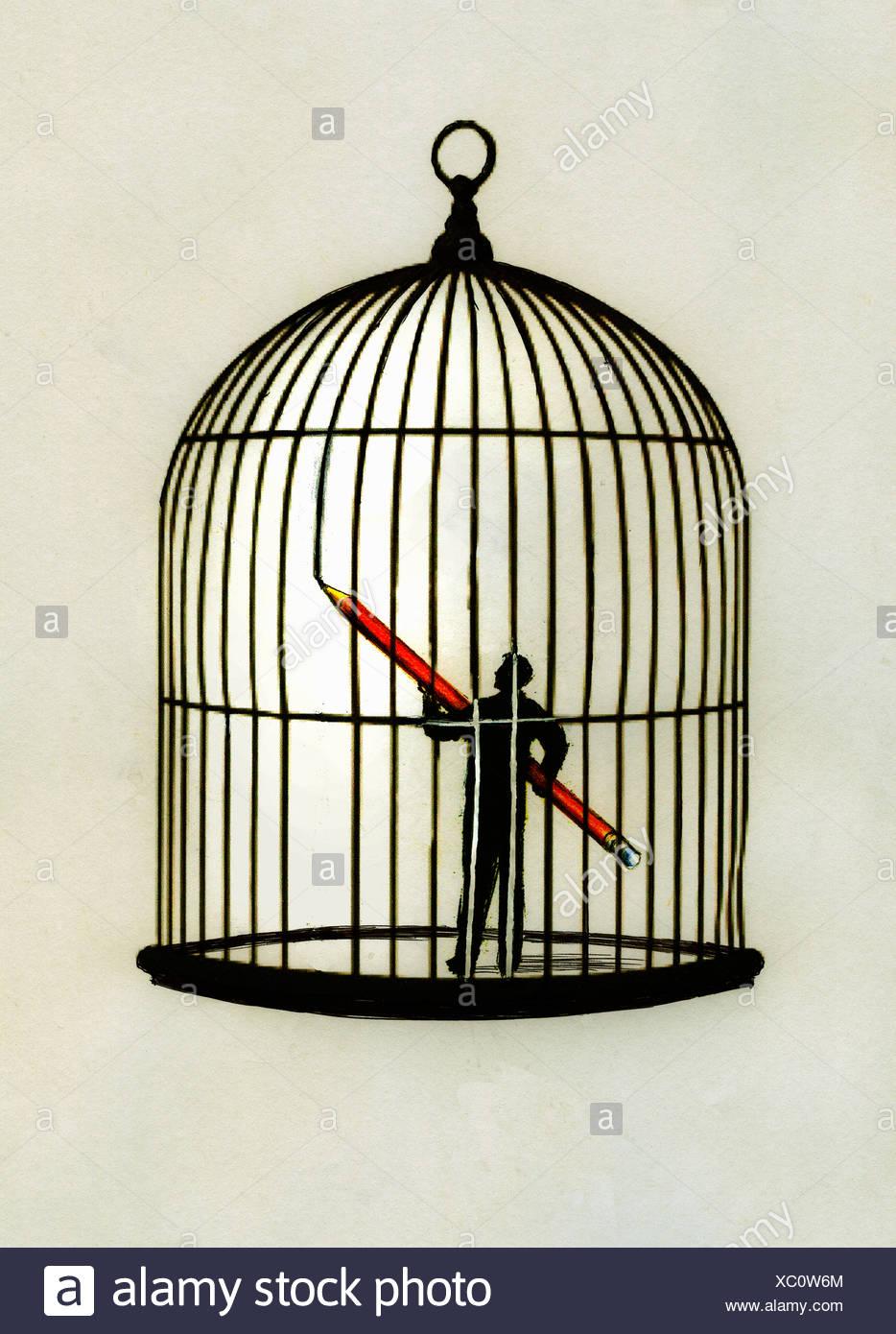 Mann im Inneren Vogelkäfig Stockbild