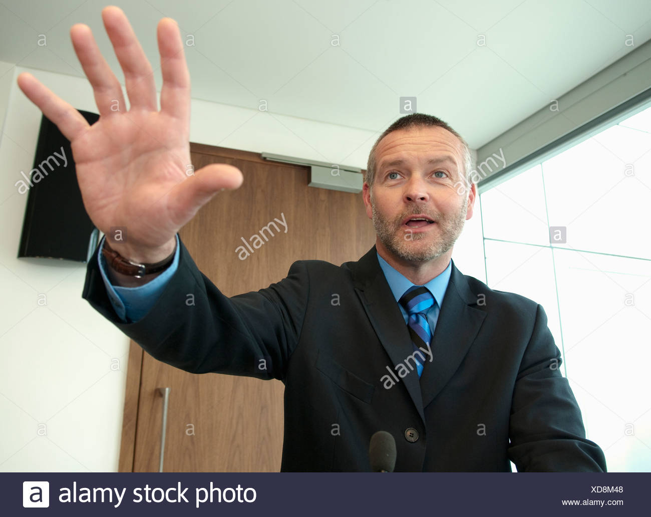 Unternehmensführer hält Rede Stockfoto
