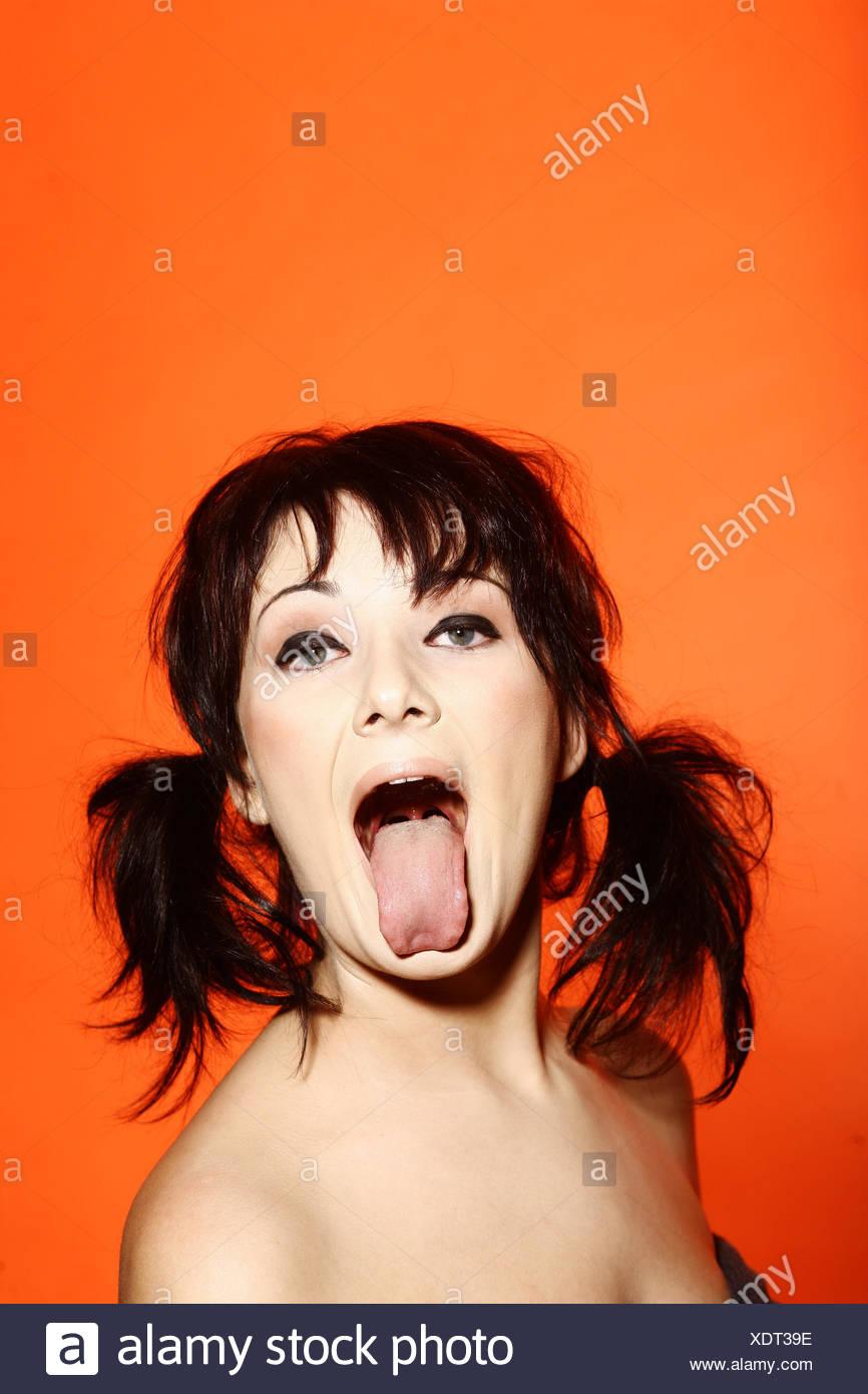 Zunge, Grimasse, albern herausragen Stockbild