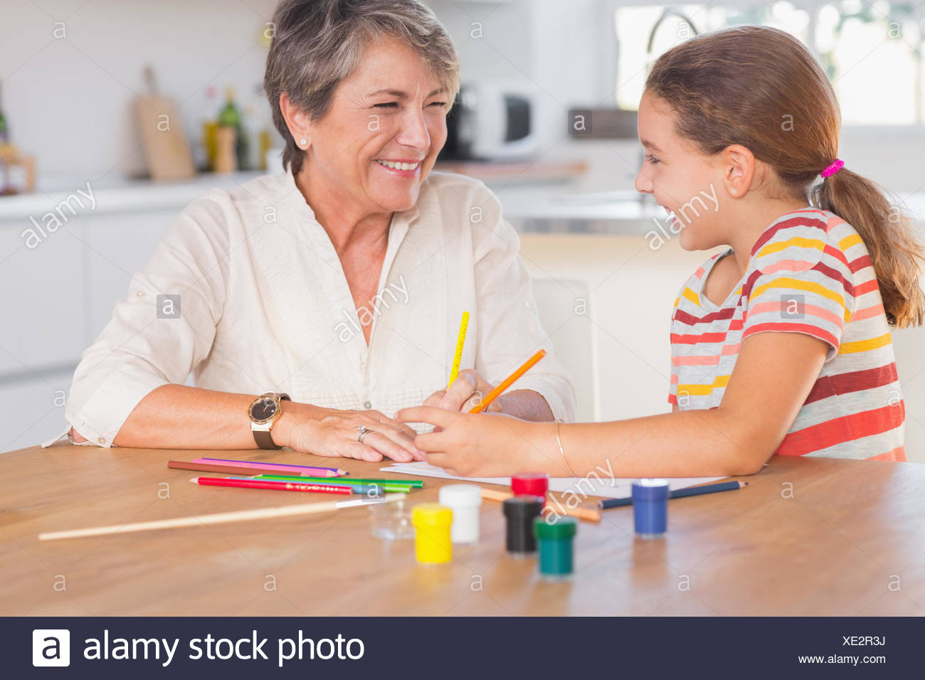 Child Granny Drawing Laughing Stockfotos Child Granny Drawing