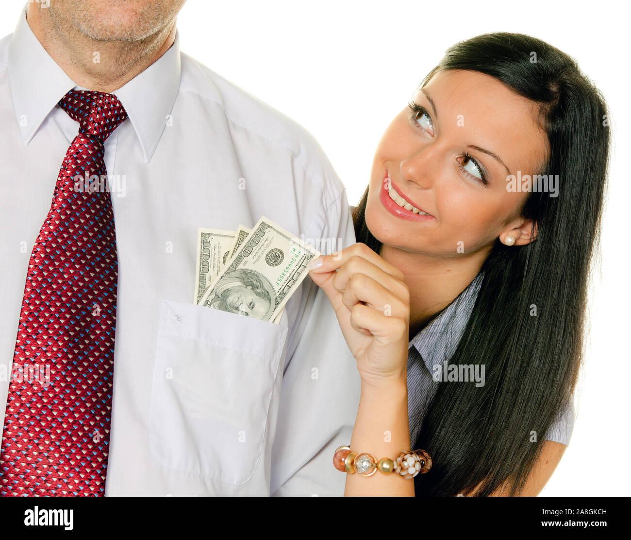 Frau Junge, 25, 30 Jahre, zieht einem Mann aus der Geld Tasche, Dólares, señor:Yes Foto de stock