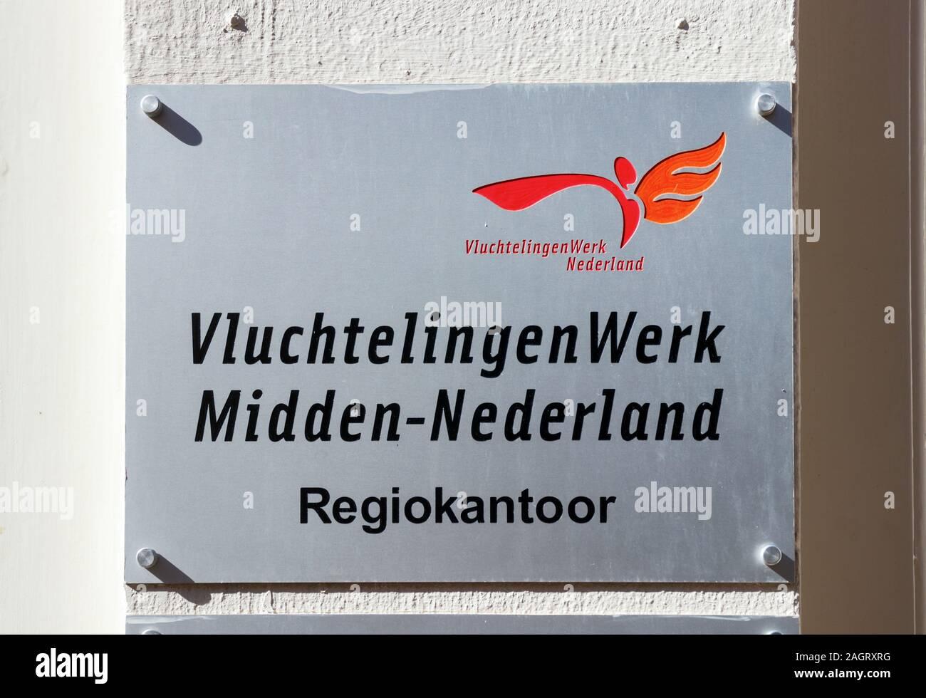 Firmar en la oficina Midden-Nederland Vluchtelingenwerk (Consejo Holandés para los Refugiados Oriente bajos). El Consejo defiende los intereses de los solicitantes de asilo. Foto de stock