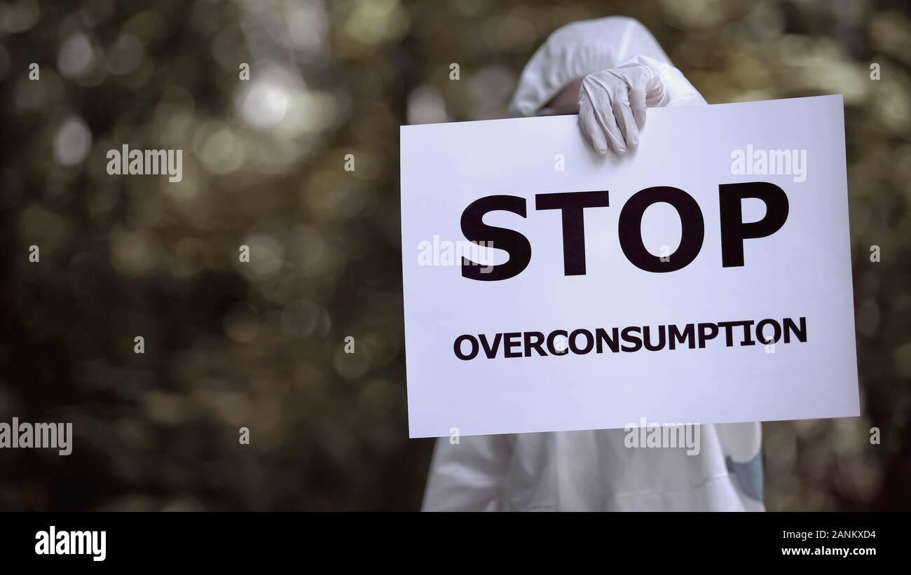 Detener el sobreconsumo signo especialista eco holding, dañando el medio ambiente, la contaminación Foto de stock