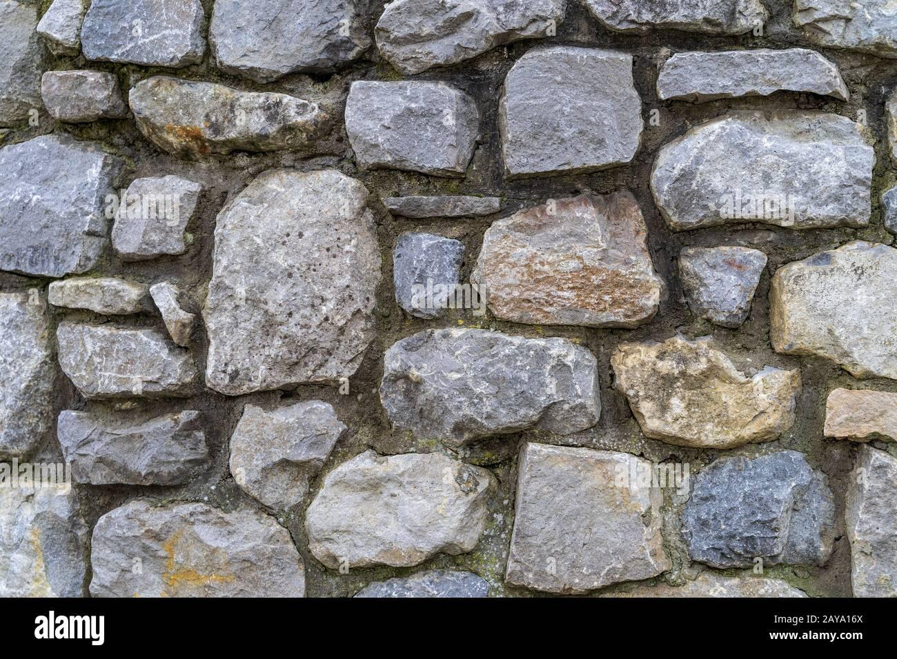 Antigua pared rústica de piedra textura y fondo de alta calidad Foto de stock