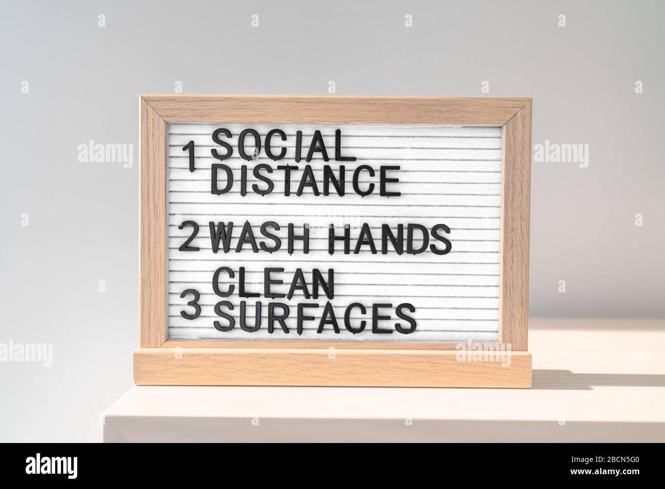 Directrices de higiene de la salud COVID-19. Reglas, distanciamiento social, lavarse las manos a menudo, limpiar las superficies, desinfectar la superficie, lavarse las manos, quedarse en casa. Aislamiento automático de coronavirus para trabajar desde casa. Foto de stock