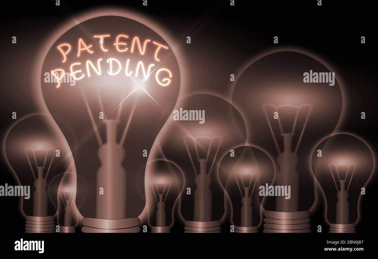 Patente de escritura de texto a mano pendiente. Foto conceptual solicitud ya presentada pero no concedida para la protección Foto de stock