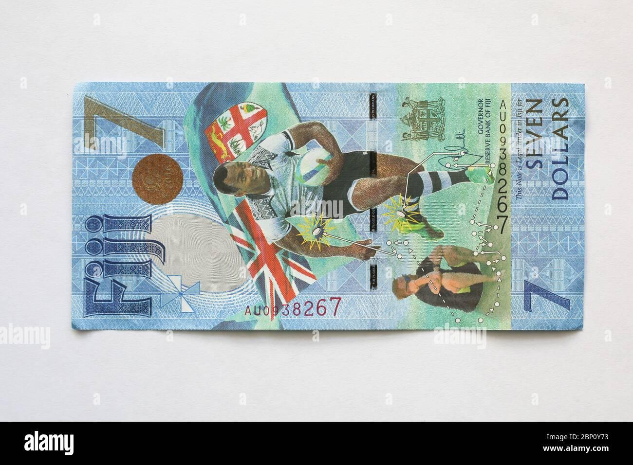 Billete de 7 dólares de Fiji que conmemora la victoria por la medalla de oro de Rugby 7 en los Juegos Olímpicos de Verano de Río 2016, Fiji, Pacífico Sur. Foto de stock