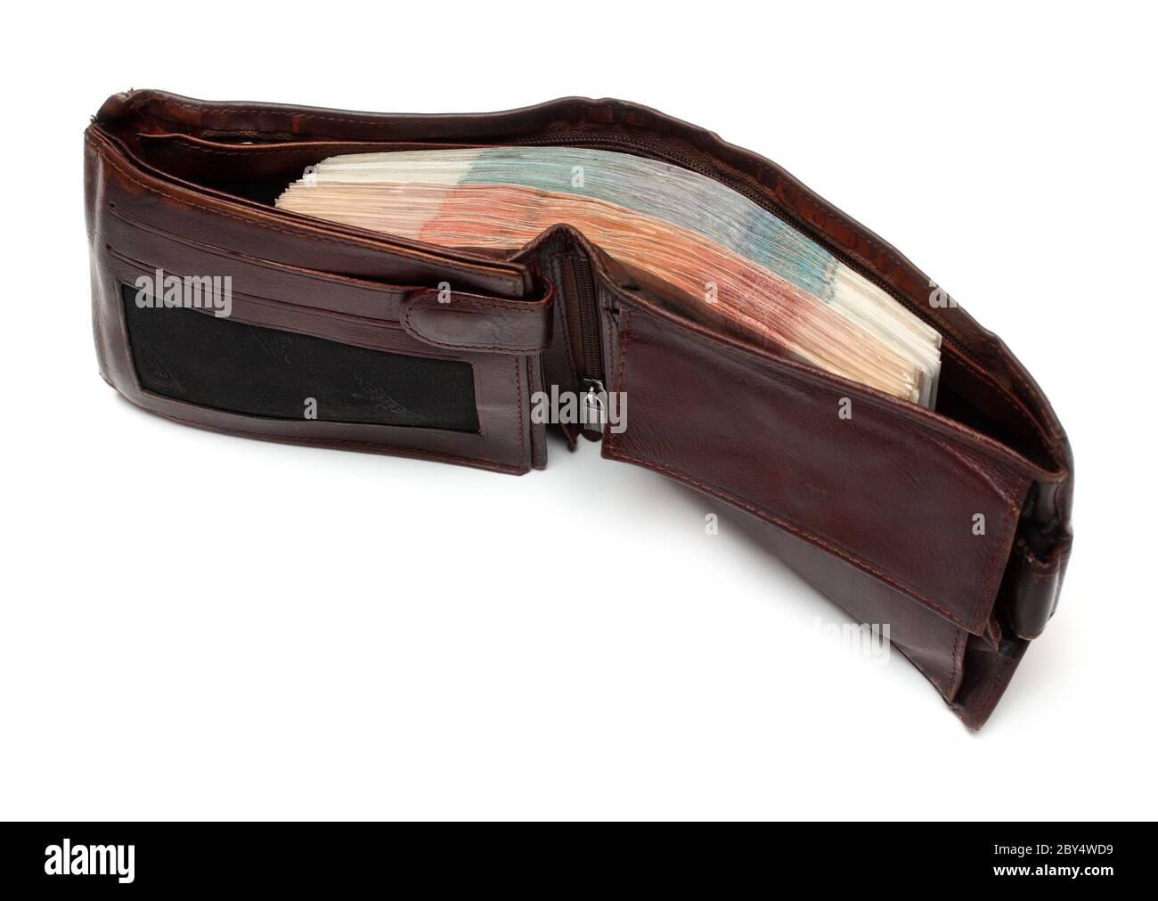 bolso marrón con billetes Foto de stock
