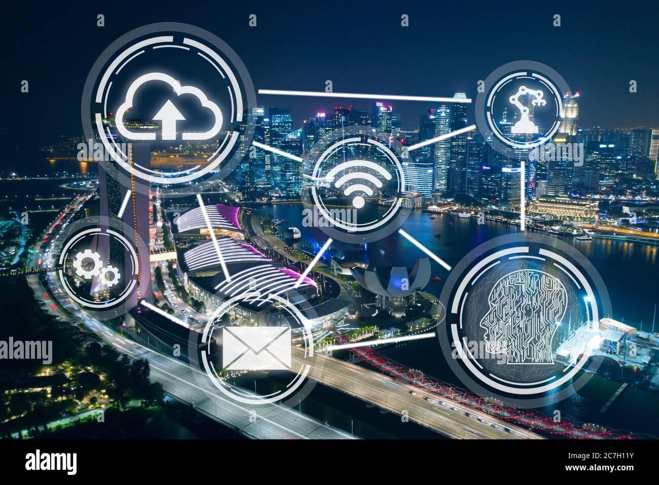 Ciudad inteligente, tecnología inalámbrica resumen sobre el fondo del distrito financiero de Singapur por la noche Foto de stock