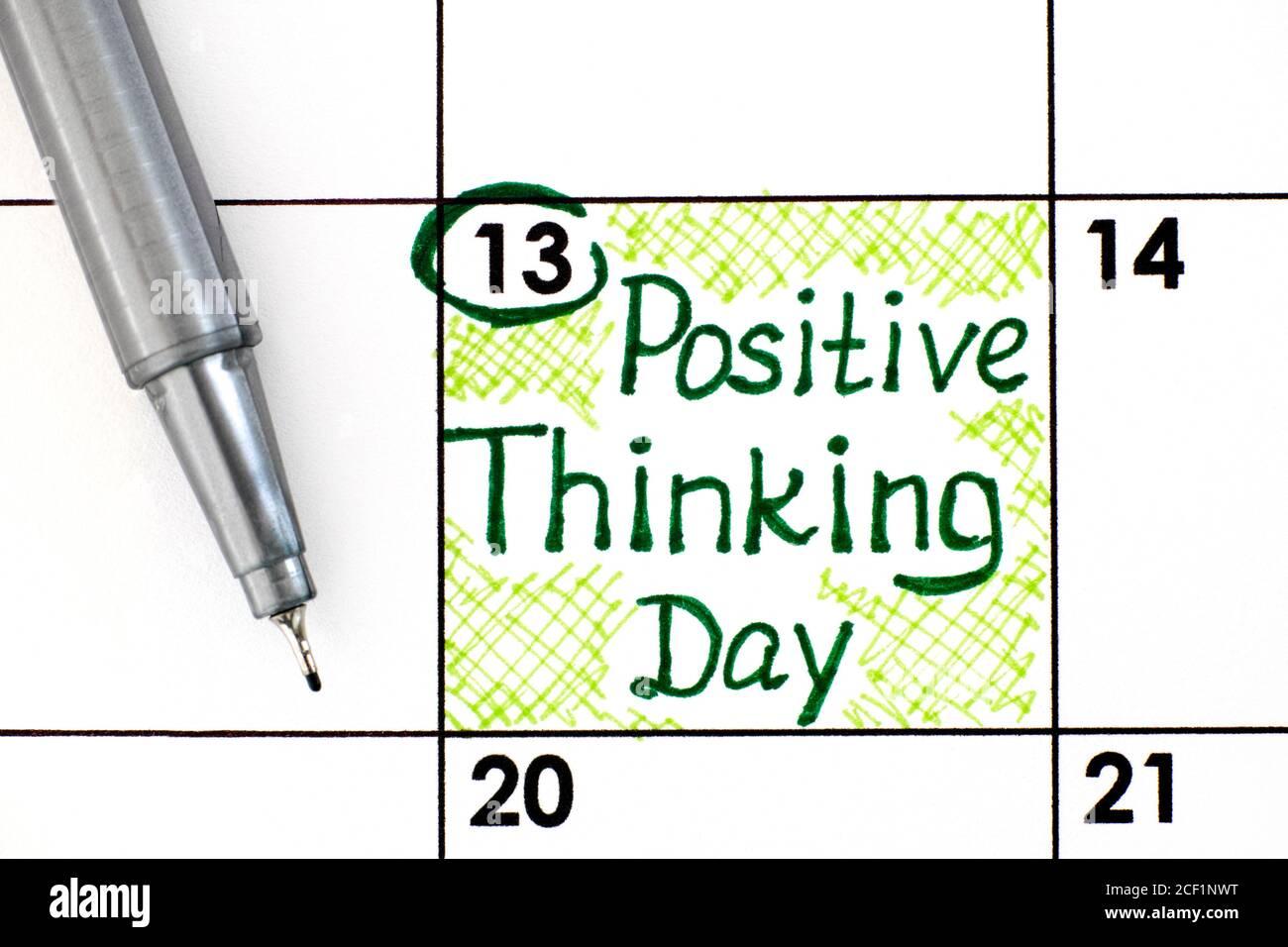 Recordatorio día de pensamiento positivo en el calendario con pluma. Septiembre de 13. Foto de stock