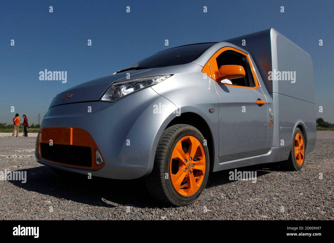 """A Furgon automobile is displayed during a ceremony to start the construction of the plant to produce Russian new car brand """"e"""" automobiles, designed by Onexim Group company, owned by billionaire Mikhail Prokhorov, outside St. Petersburg June 8, 2011. Russian new car brand """"e"""" (""""e with two dots above"""" is the seventh letter in Russian alphabet) automobiles will become the world's cheapest hybrids, priced at $10,000, according to the company's representatives.  REUTERS/Alexander Demianchuk  (RUSSIA - Tags: BUSINESS TRANSPORT) Foto de stock"""