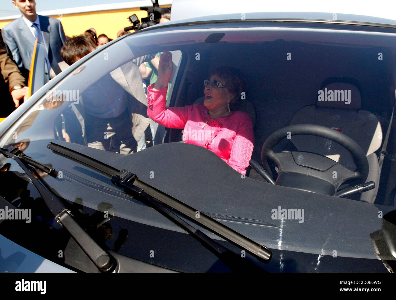 """St. Petersburg's Governor Valentina Matviyenko sits in a Furgon automobile as she takes part in a ceremony to start the construction of the plant to produce Russian new car brand """"e"""" automobiles, designed by Onexim Group company, owned by billionaire Mikhail Prokhorov, outside St. Petersburg June 8, 2011. Russian new car brand """"e"""" (""""e with two dots above"""" is the seventh letter in Russian alphabet) automobiles will become the world's cheapest hybrids, priced at $10,000, according to the company's representatives.  REUTERS/Alexander Demianchuk  (RUSSIA - Tags: BUSINESS TRANSPORT CONSTRUCTION POL Foto de stock"""