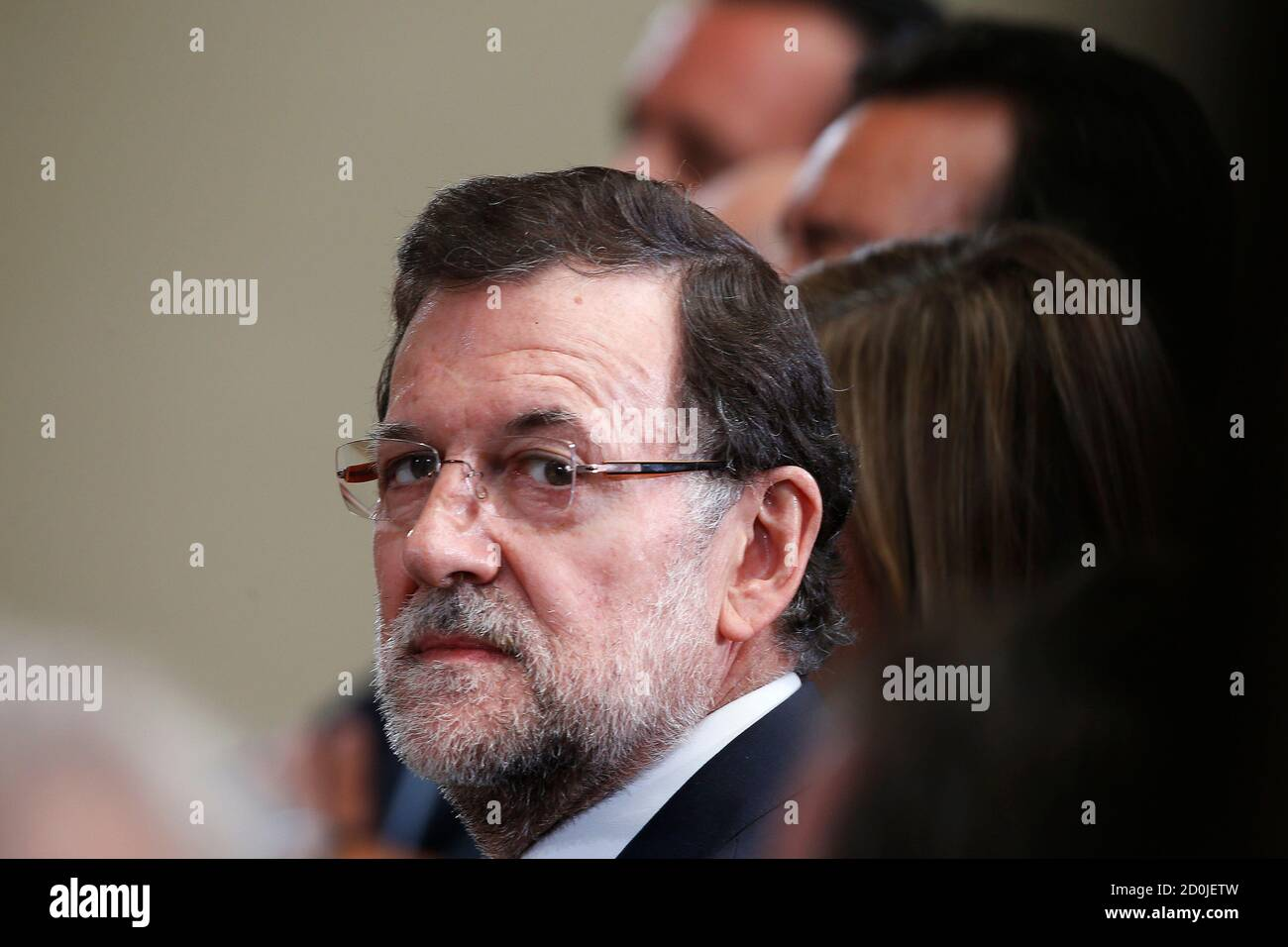 Spain's Prime Minister Mariano Rajoy attends a presentation on social action entities at the Moncloa Palace in Madrid July 11, 2013. Spain's Prime Minister Mariano Rajoy may take a pounding from fresh corruption allegations against his People's Party but the government is strong enough to ride the storm, analysts and sources say. REUTERS/Juan Medina (SPAIN - Tags: POLITICS) Foto de stock