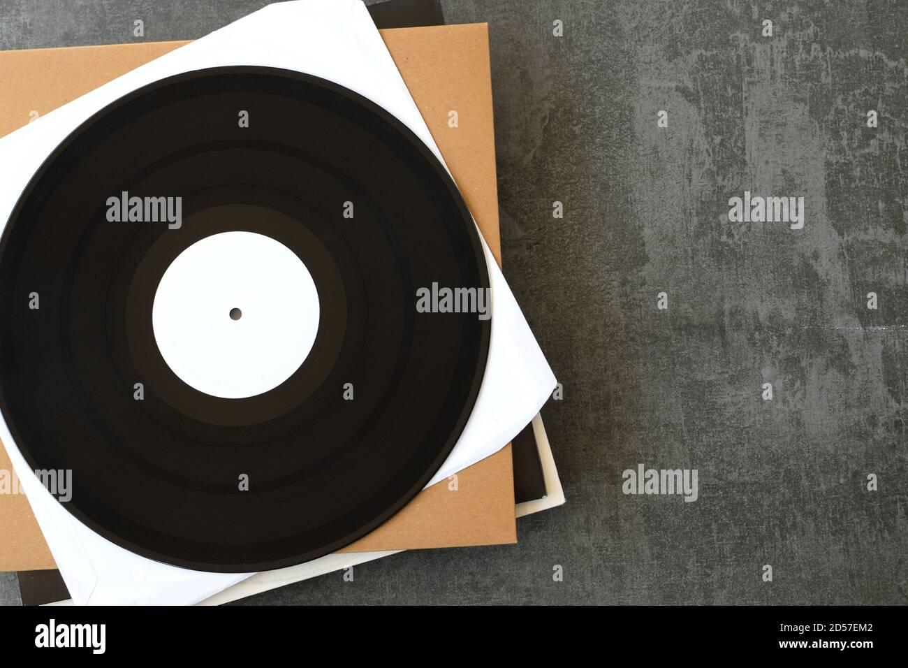 Etiqueta blanca vinilo graba fondo de música con espacio de copia. Foto de stock