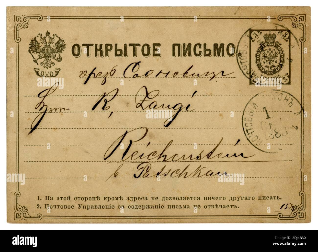 Tarjeta postal histórica rusa con águila de doble cabeza, sello postal impreso, sello postal del coche de correo, carta a Patschkau, Imperio Alemán, 1883 Foto de stock