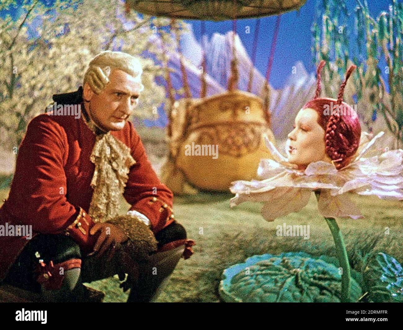 MÜNCHHAUSEN 1943 producción de Universum Film con Hans Albers en el Título papel aquí conocer a la Reina de la Luna jugado por Marianna Simson Foto de stock