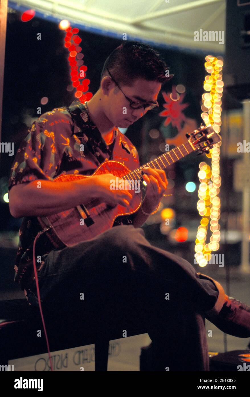 Local Hawaiian favorite ukulele maestro Jake Shimabukuro performing at Aloha Tower Foto de stock