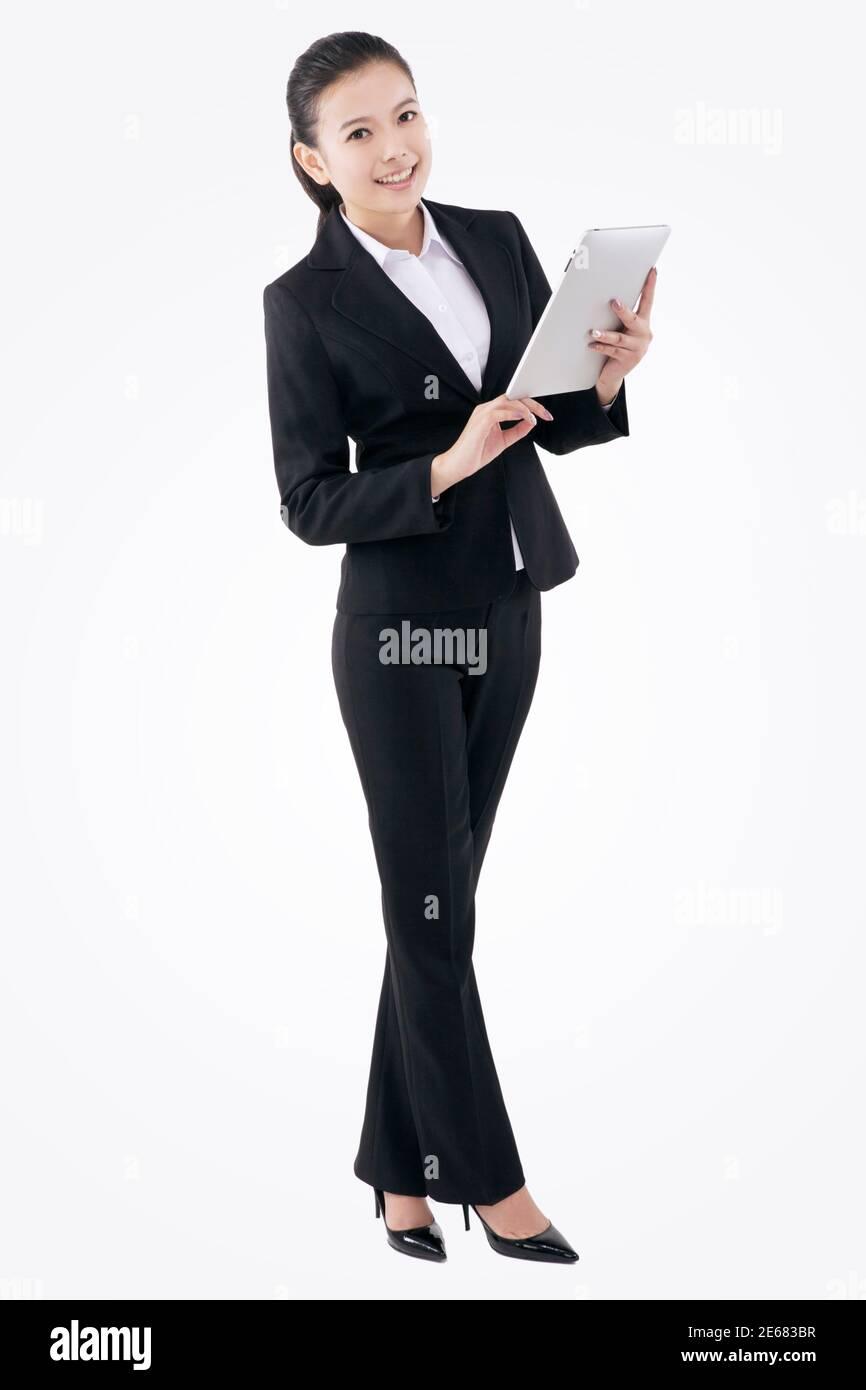 Mujer de negocios de moda oriental y IPAD foto de alta calidad Foto de stock