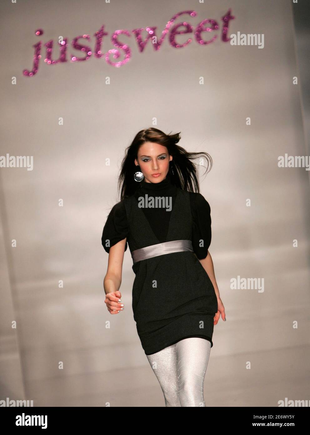 A model presents a creation from the Justsweet creation by Jennifer Lopez during Fashion Week in Miami Beach, Florida, March 23, 2006. Photo taken March 23, 2007.   REUTERS/Carlos Barria (UNITED STATES) Foto de stock