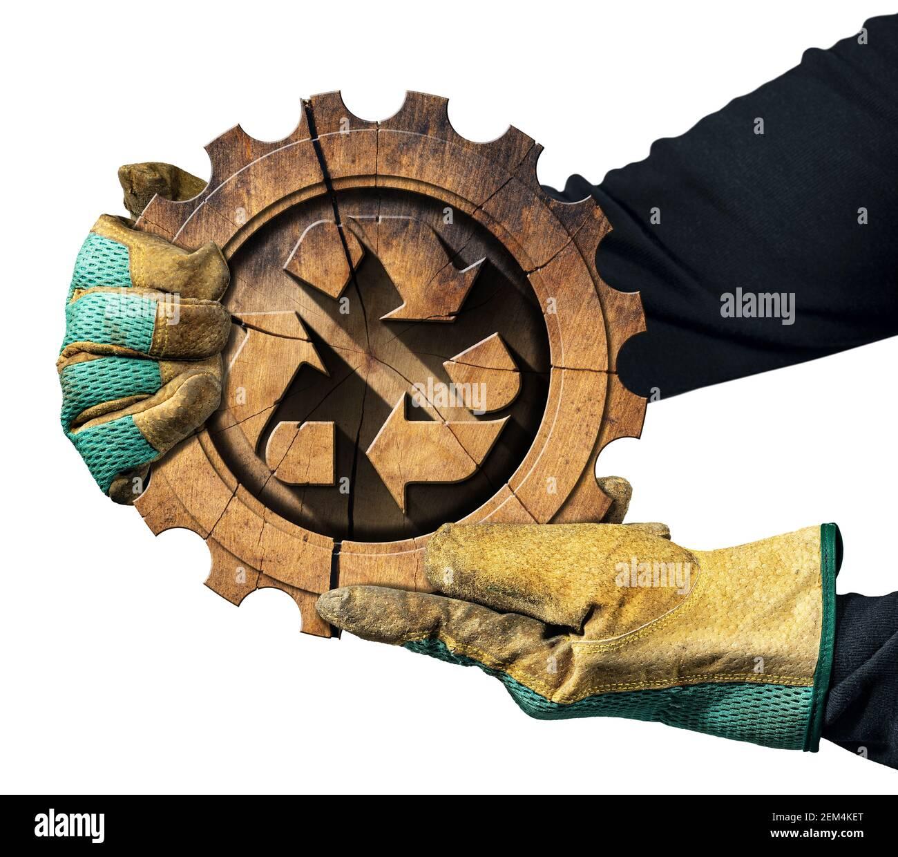 Manos enguantadas mostrando un símbolo de reciclaje hecho de madera dentro de una rueda dentada. Concepto de Recursos sostenibles. Aislado sobre fondo blanco. Foto de stock