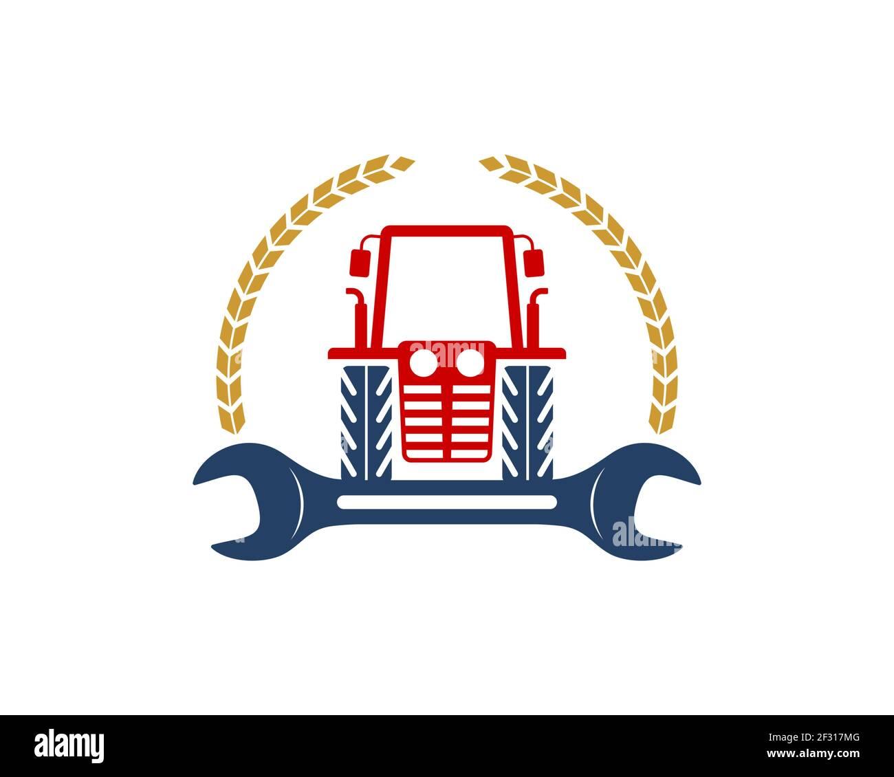 Tractor agrícola con llave de reparación y trigo circular Foto de stock
