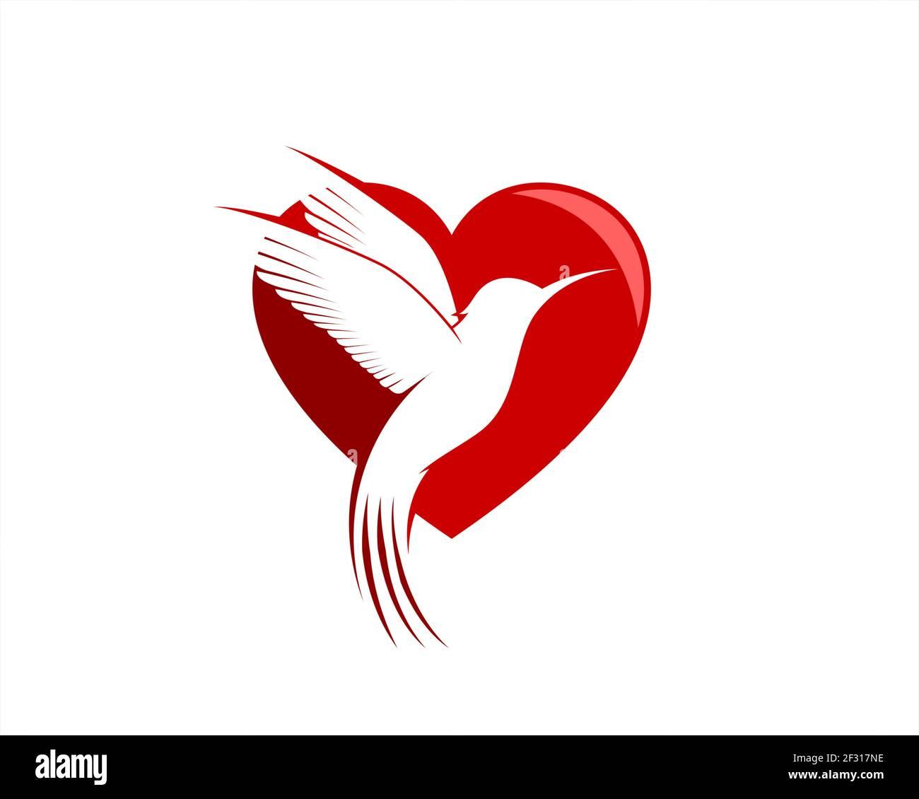 Forma de amor con la paloma voladora de lujo Foto de stock