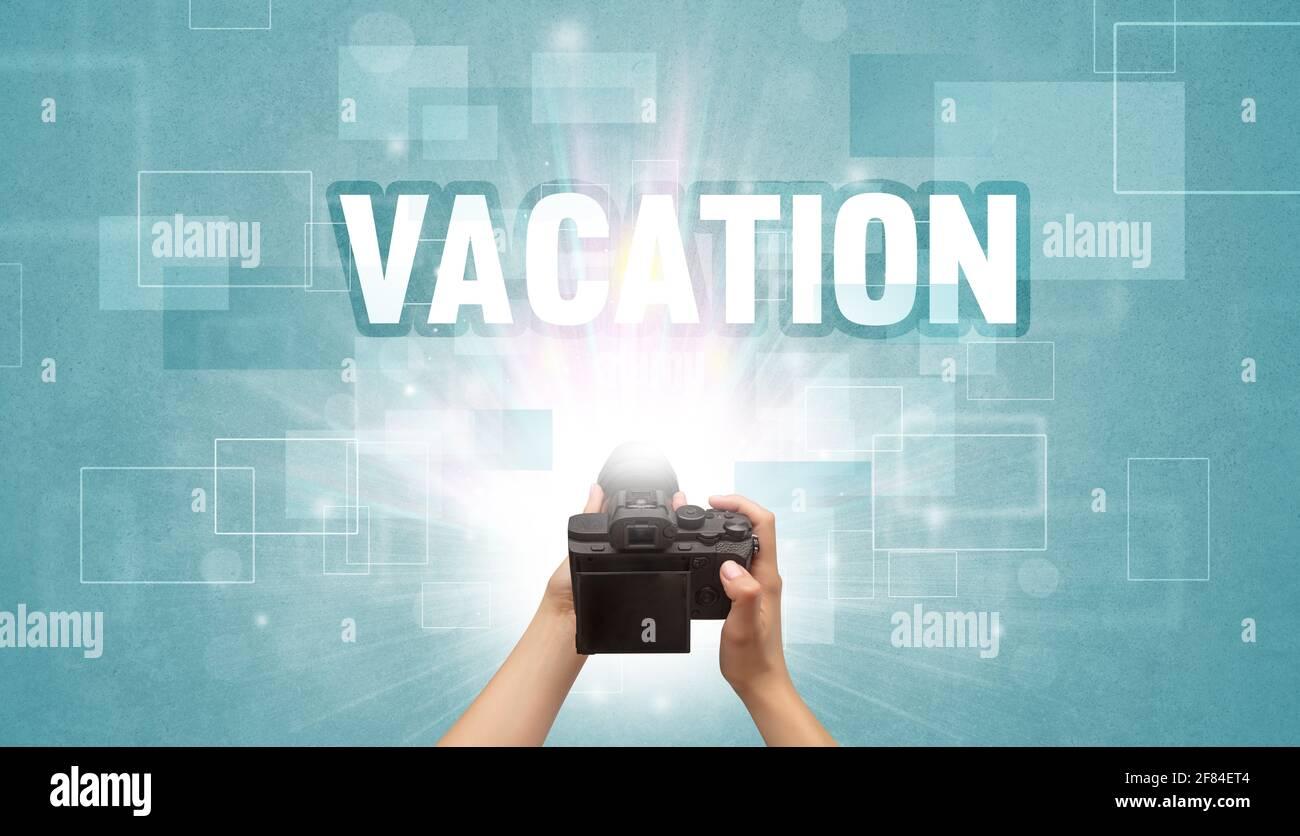 cámara digital de mano, concepto de viaje Foto de stock