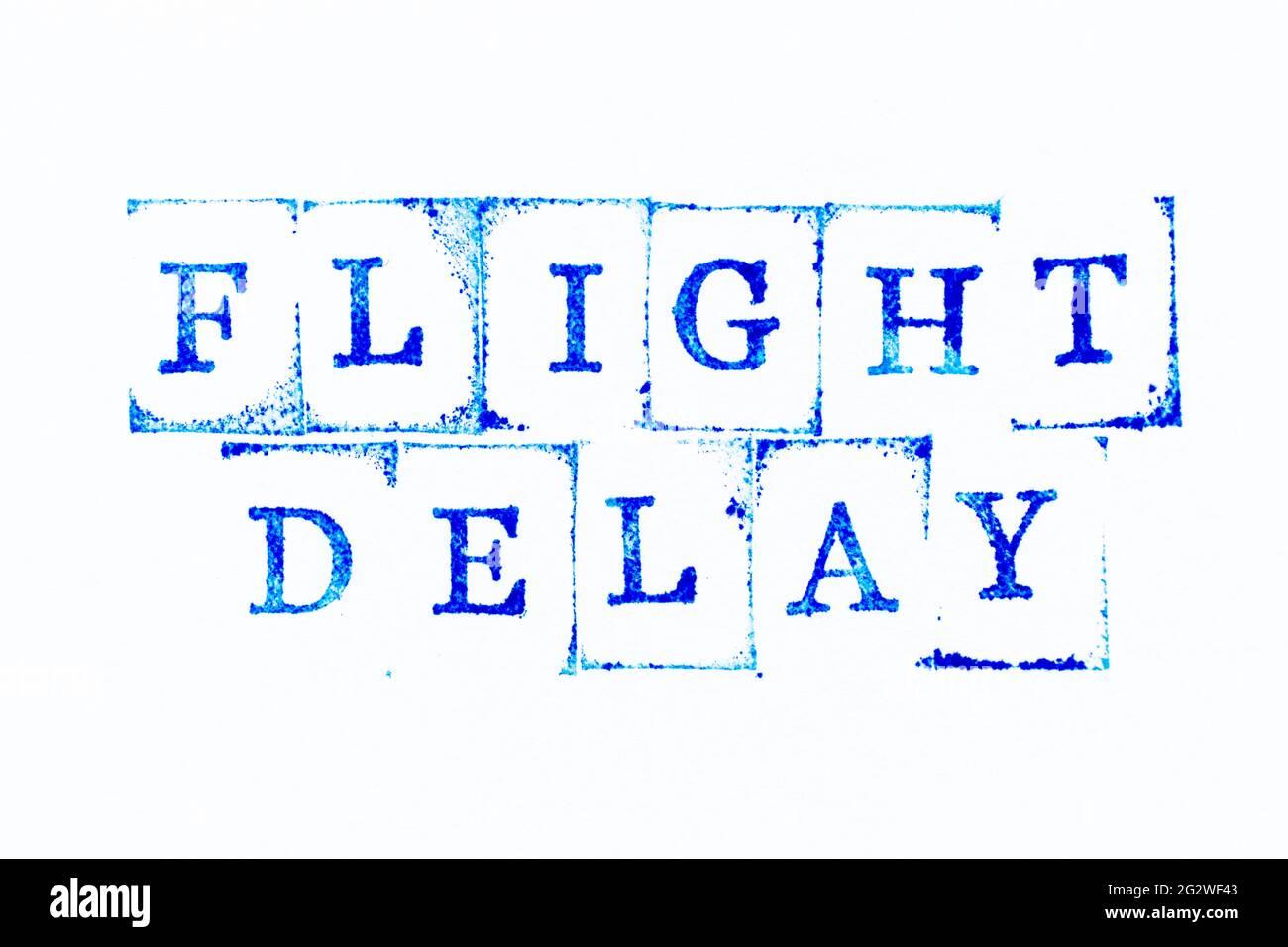 Sello de goma de tinta de color azul en retardo de vuelo de palabra sobre fondo de papel blanco Foto de stock