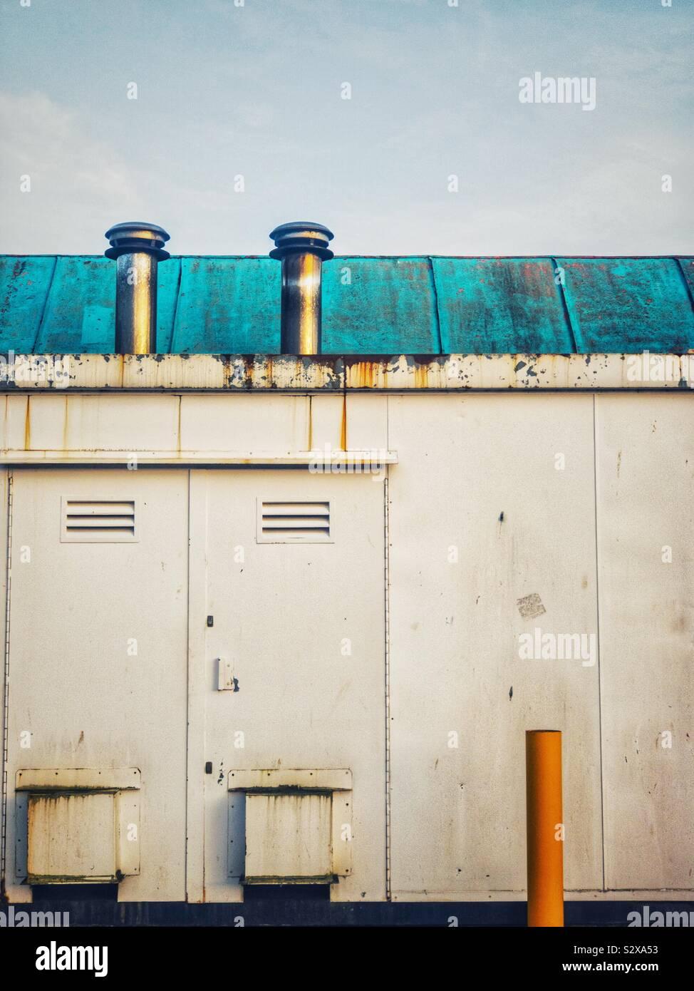 Industrial equipment on side of building. Foto de stock