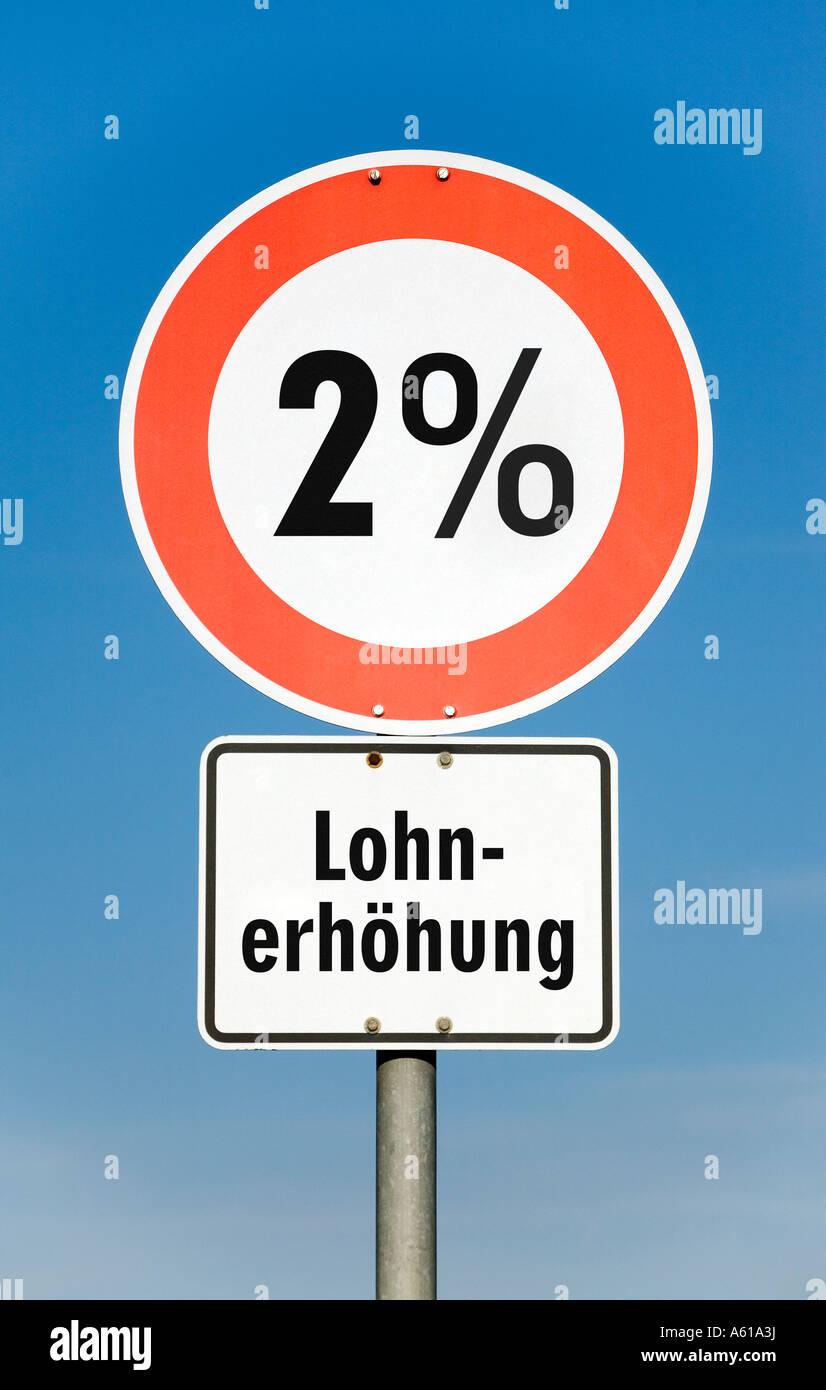 2 por ciento de aumento en los salarios Imagen De Stock