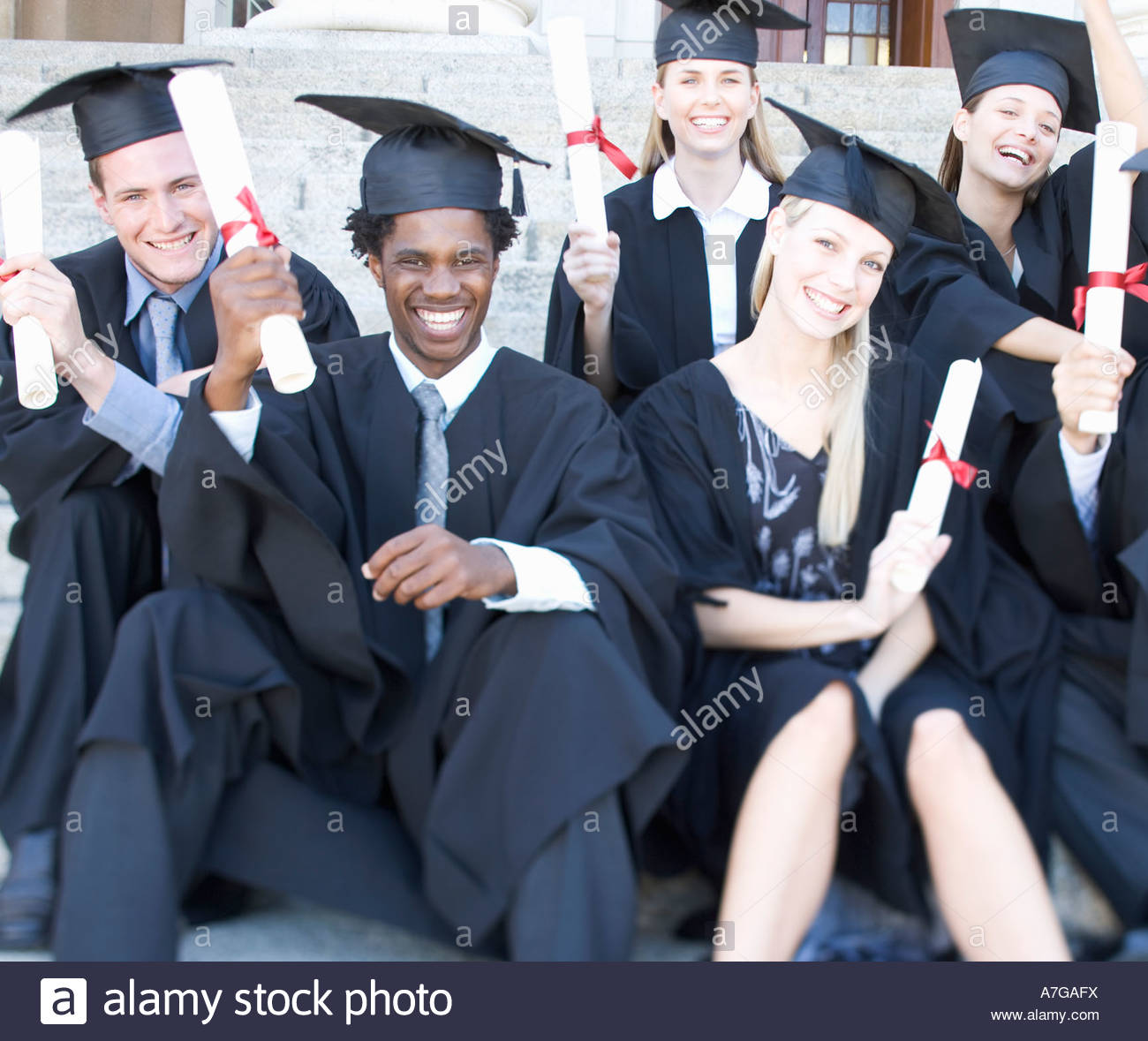 Un grupo de graduados celebrando Imagen De Stock