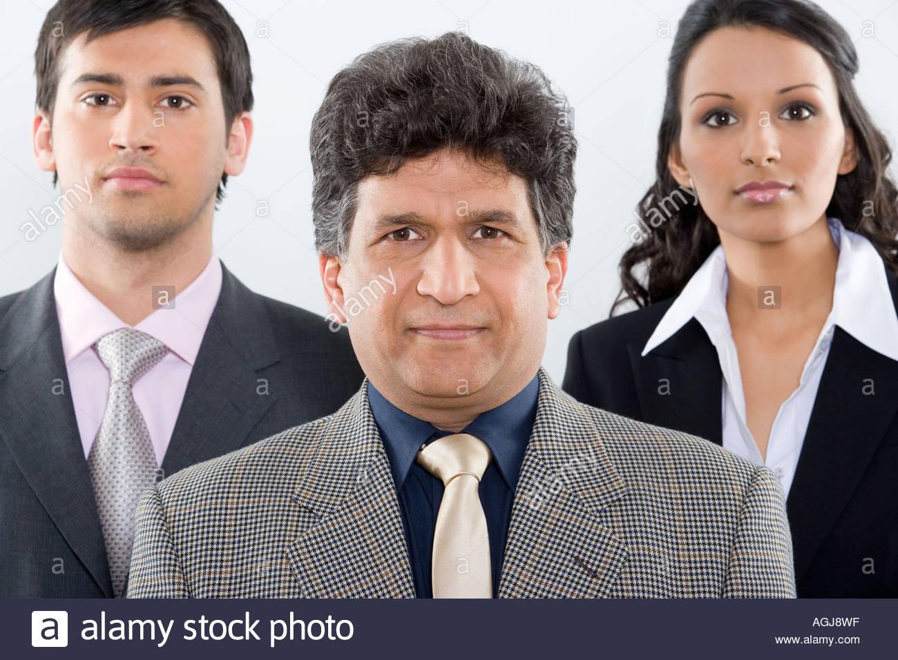 Tres colegas en una fila Imagen De Stock