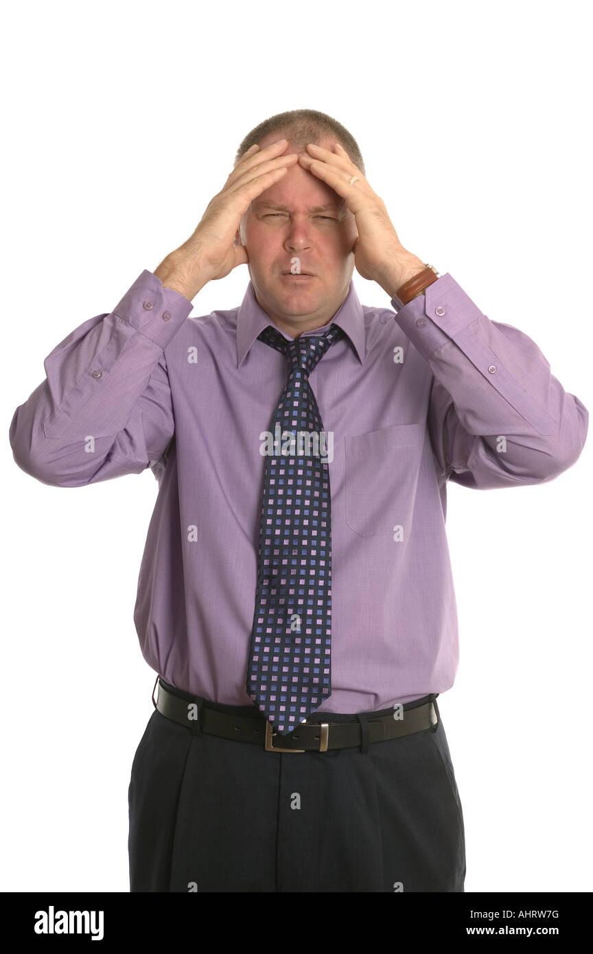 Empresario con una expresión de estrés en su rostro. Imagen De Stock