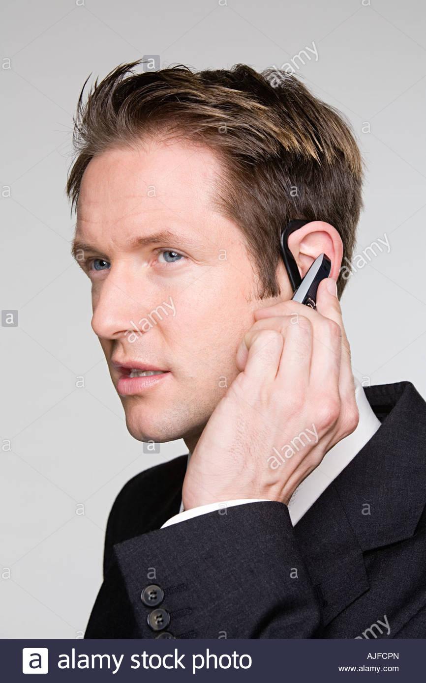 Empresario con dispositivo manos libres Imagen De Stock