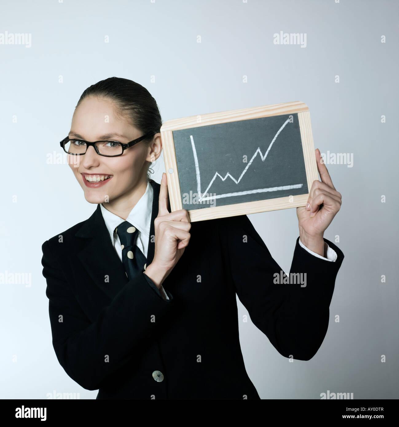 Foto de estudio retrato de una hermosa joven en un traje traje Imagen De Stock
