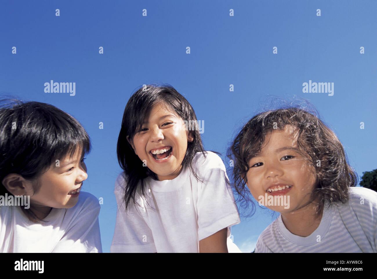 Rostros de tres niñas Foto de stock