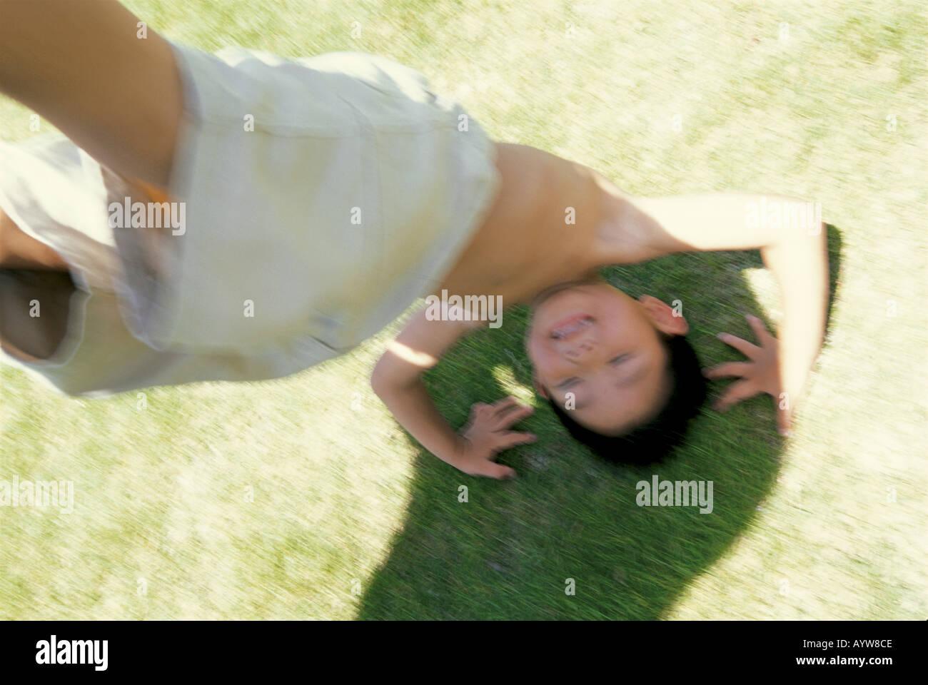 Boy handstanding Foto de stock