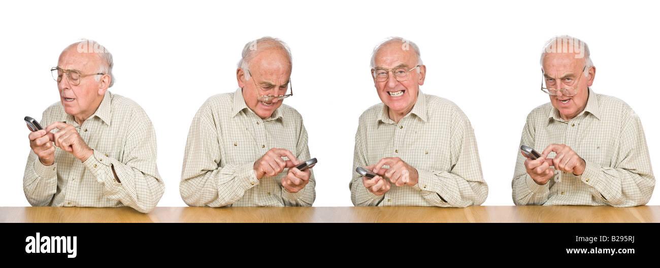 Una secuencia compuesta de un anciano frustrado intentando texto o utilizar el teléfono móvil con los pequeños botones y números. Foto de stock