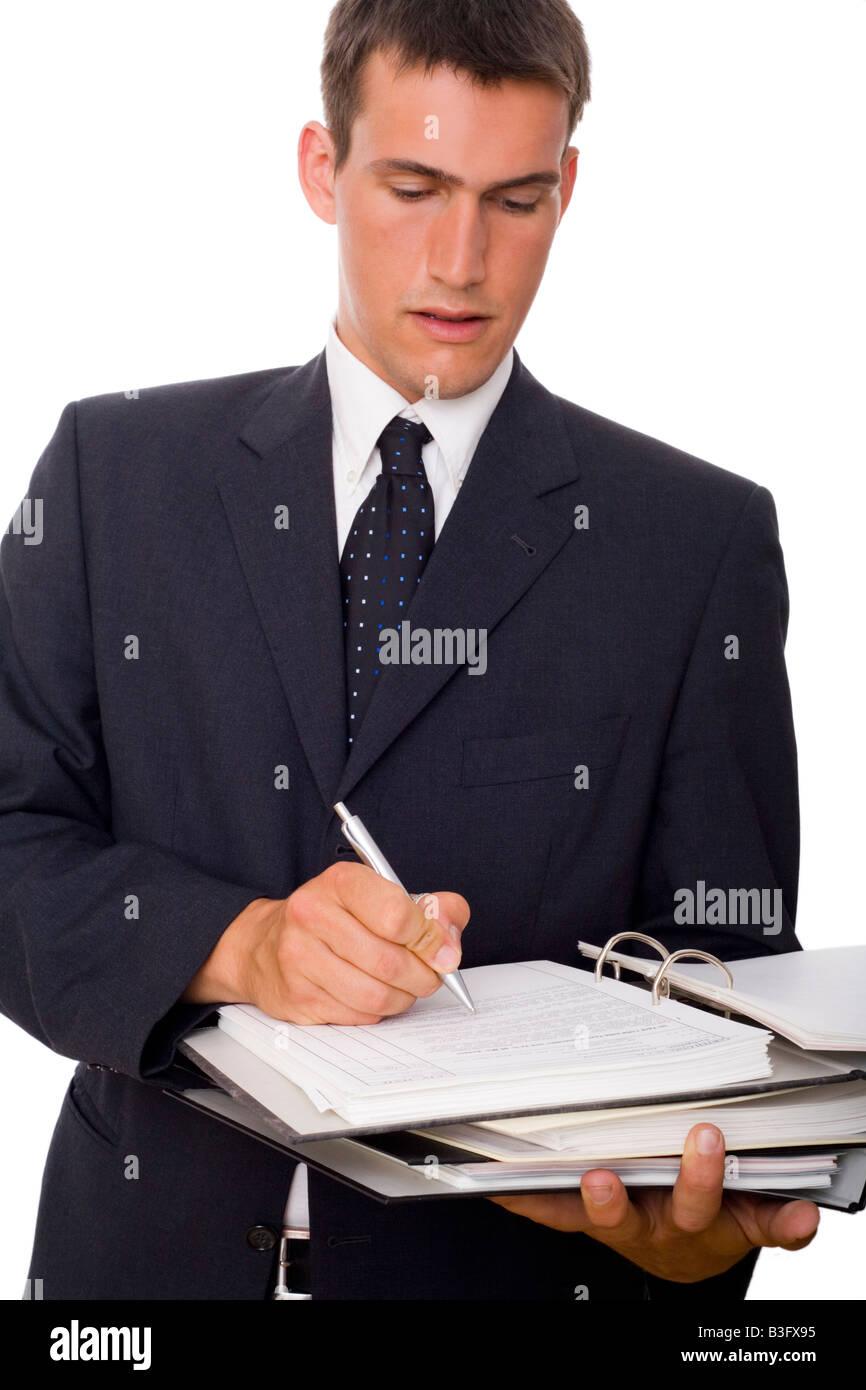Hombre escrito en archivos Foto de stock