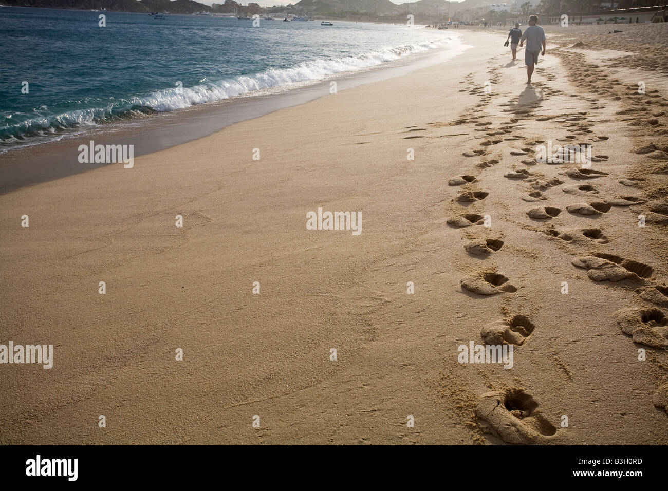 Personas en la playa Foto de stock